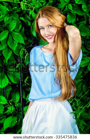 Happy elegant young woman with beautiful smile outdoors. Beauty, fashion. Summer vacation. - stock photo
