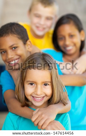 happy elementary school friends outdoors - stock photo
