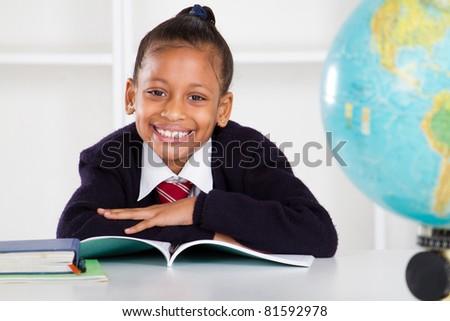 happy elementary school girl in classroom - stock photo