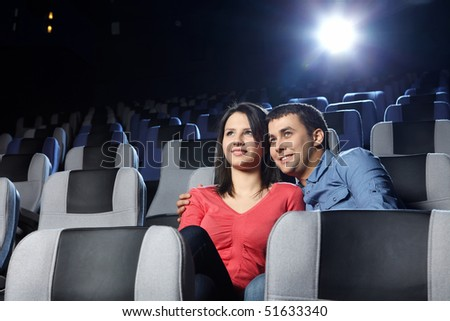 Happy enamoured at a cinema look a film - stock photo