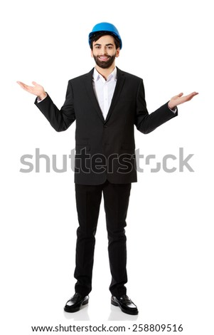 Happy engineer businessman showing empty copyspace on hands. - stock photo