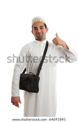Happy ethnic arab man showing a thumbs up hand sign.  White background. [May be offesive gesture in Middle Eastern Countries and Internationally] - stock photo