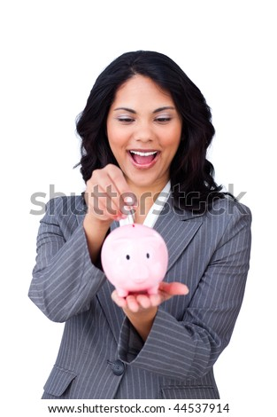Happy ethnic businesswoman saving money in a piggy-bank isolated on a white background - stock photo