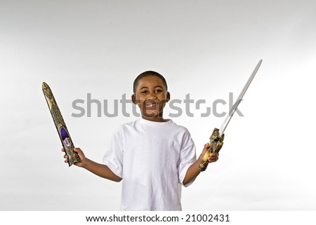 happy ethnic child portrait smiling looking at camera with toy - stock photo