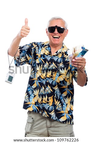 Happy excited senior holding money and camera gesturing thumbs up, isolated on white background. - stock photo