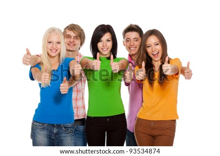 Happy excited smiling friends holding thumb up gesture, group of young people students standing point finger hands at you together isolated on white background - stock photo