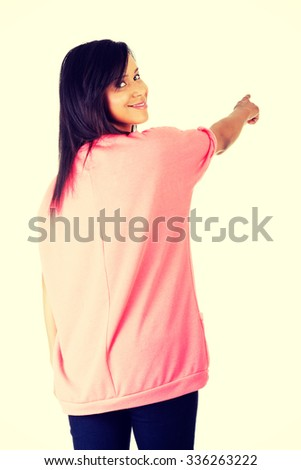Happy , excited young woman pointing on copy space. - stock photo