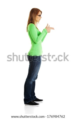 Happy , excited young woman pointing on copy space, isolated on white  - stock photo