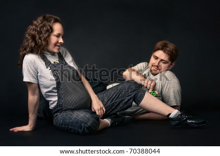 happy expecting pregnant couple