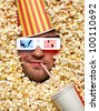 Happy face in popcorn with bucket on head watching 3D movie and drinking soda - stock photo