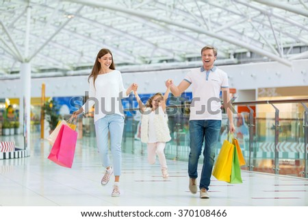 Happy families with a child in a store