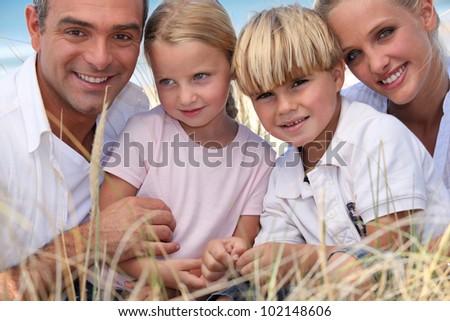 happy family at beach - stock photo