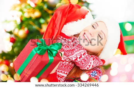 happy family at Christmas. mother and child daughter hugging and give gifts - stock photo