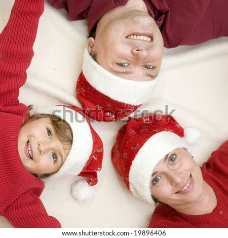 Happy family at Christmas time - stock photo