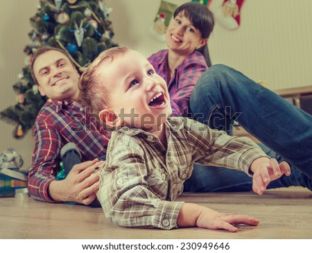 Happy family at home in christmas time - stock photo