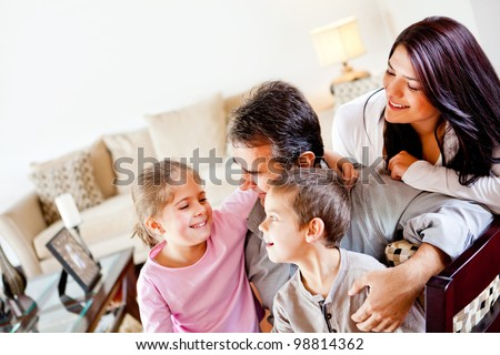 Happy family at home spending time together and smiling - stock photo