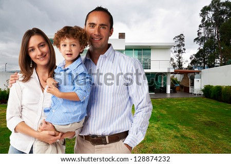 Happy Family at new big house - stock photo