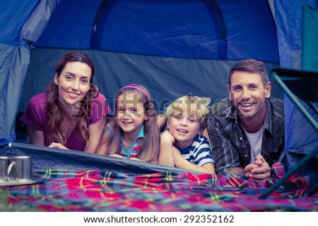 Happy family camping in the park on a sunny day