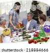 Happy family celebrating Christmas dinner with turkey against snowflake frame - stock photo