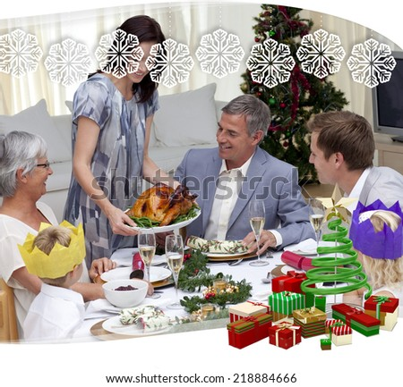 Happy family celebrating Christmas dinner with turkey against snowflake frame