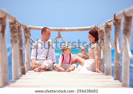 happy family celebrating wedding together on tropical island - stock photo
