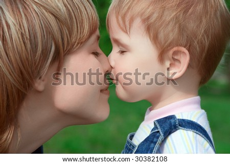 happy family child and mother over green - stock photo