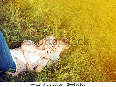 Happy family concept. Mother and her child son enjoying summer and playing. Sunny summer weather. Close up. Outdoor shot. Copy-space. - stock photo