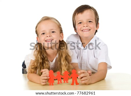 Happy family concept with kids holding paper people - isolated - stock photo