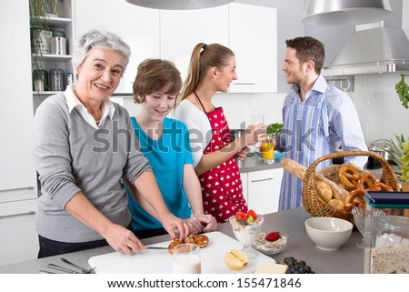 Happy family cooking together at kitchen. - stock photo