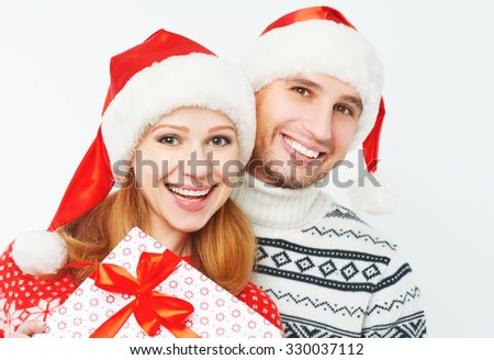 Happy family couple with Christmas presents on a white background - stock photo