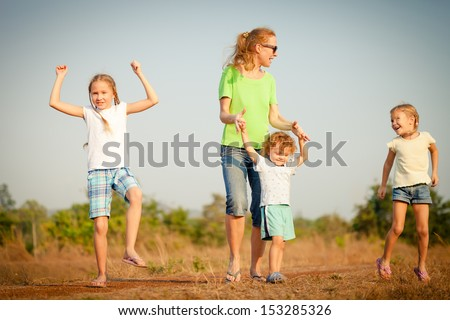 happy family dancing on the road - stock photo