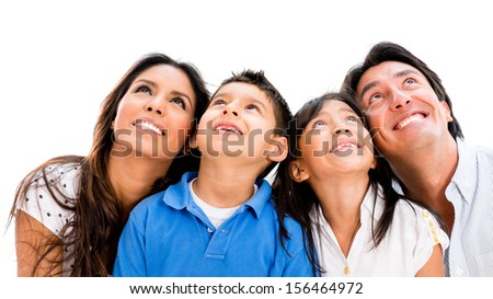 Happy family daydreaming and looking up - isolated over white background  - stock photo