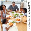 Happy family dining together in the kitchen - stock photo