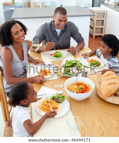 Happy family dining together in the kitchen