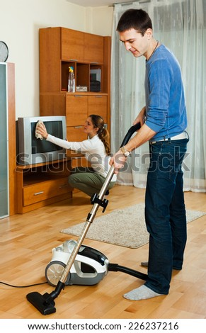 Happy family doing housework together in home - stock photo