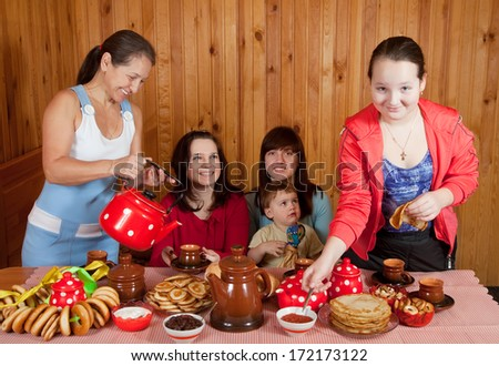Happy family  drinking tea with russian traditional snack