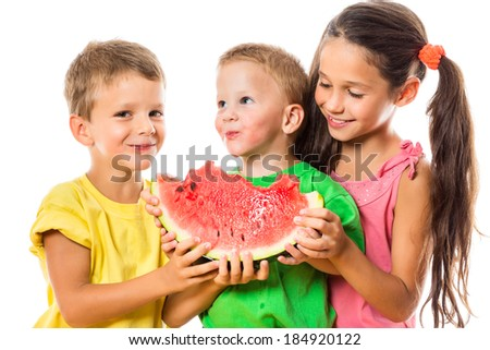 Happy family eating a watermelon, isolated on white - stock photo