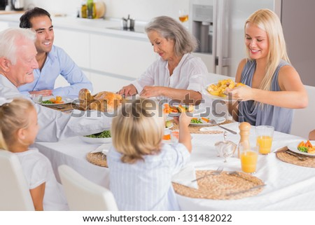 Happy Family eating the thanksgiving dinner together - stock photo