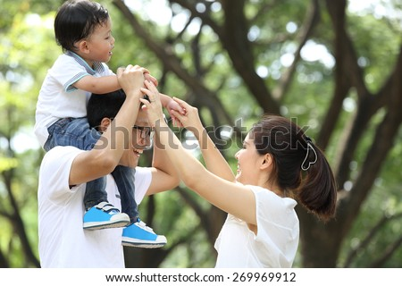 Happy Family enjoy and do activity together in Garden. - stock photo