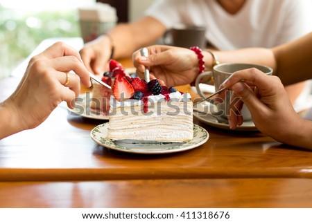 Happy family enjoy eating cake in the restaurant - stock photo