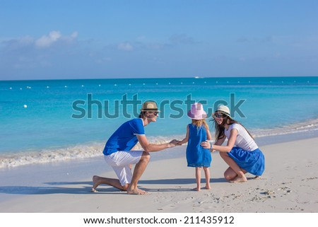 Happy family enjoying beach vacation