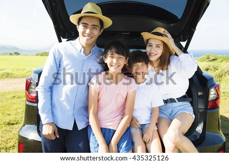 happy family enjoying road trip and summer vacation