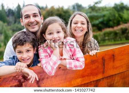 Happy family enjoying their time together in the countryside - stock photo