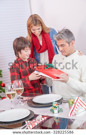 Happy family exchanging gifts for Christmas. - stock photo