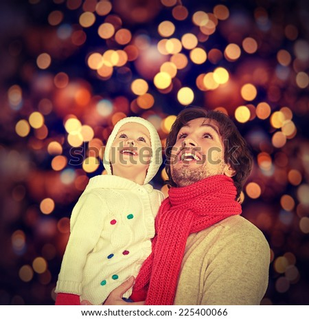 happy family father and child baby daughter and a Christmas miracle - stock photo