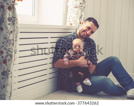 Happy family father and child baby son playing together at home - stock photo