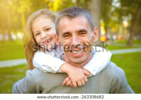 Happy family. Father and daughter having fun. soft light