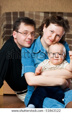 Happy family. Father and mother embrace the small son.