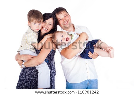 Happy family father and mother with children posing in the studio on a white background. A series of photos in my portfolio.