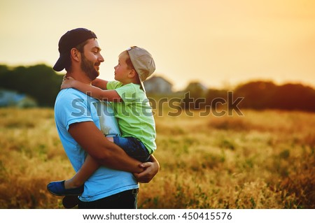 Happy family. Father and son playing and embracing the outdoors. Father's day - stock photo